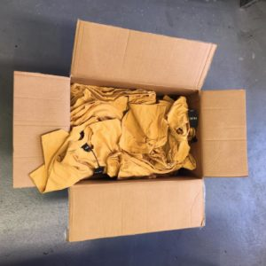 Box of messy t-shirts without folding and bagging
